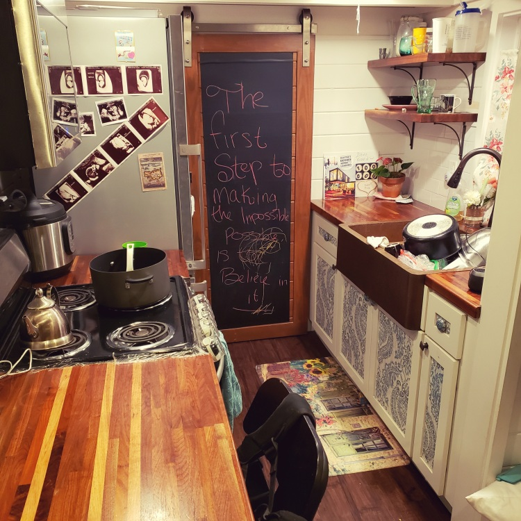 tiny house kitchen with farmhouse sink and full sized appliances